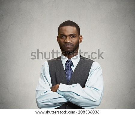 Closeup portrait angry, mad, annoyed, bitter, suspicious, business man, unhappy, looking at you, isolated grey background. Human emotion, face expression, attitude, interpersonal conflict resolution - stock photo