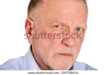 Closeup portrait angry, mad, annoyed, suspicious, senior business man, unhappy, looking at you, isolated white background. Human emotion, face expression, attitude, interpersonal conflict resolution