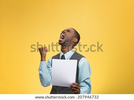 Closeup portrait angry, mad, screaming business man holding paper, document, screaming, looking up isolated yellow background. Negative emotions, facial expression, feeling. Financial crisis, bad news - stock photo