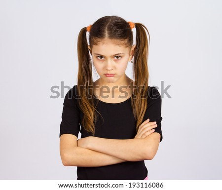 Closeup portrait angry, sad, upset, grumpy, stressed little young girl, about have nervous breakdown, isolated black grey background. Negative human emotion facial expression feeling attitude reaction - stock photo