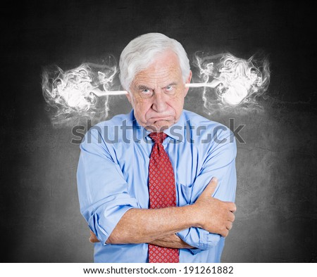 Closeup portrait angry senior business man, blowing steam coming out of ears, about to have nervous atomic breakdown, isolated black background. Negative emotions, facial expression, feeling, attitude - stock photo