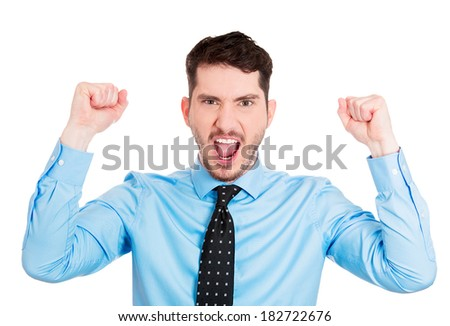 Closeup portrait angry, upset, young man, worker, mad employee, funny looking business man, fists in air, open mouth yelling, isolated white background. Negative emotions, facial expression, reaction - stock photo