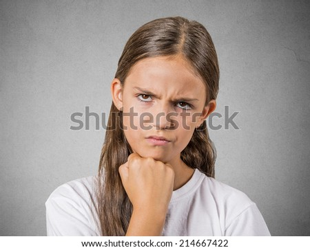 Closeup portrait angry young girl, unhappy teenager about to have nervous, atomic breakdown, isolated grey wall background. Negative human emotions, facial expressions, reaction, feelings, attitude - stock photo