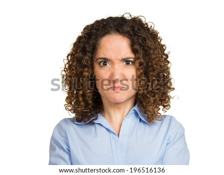 Closeup portrait angry young woman disgusted with situation, full of hatred about to have nervous atomic breakdown isolated white background. Negative human emotion, facial expression feeling attitude - stock photo