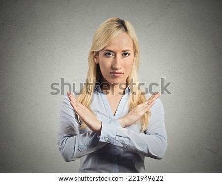 Closeup portrait angry young woman with X gesture to stop talking, cut it out, dont go there, isolated grey wall background. Negative emotion facial expression feeling sign symbols, body language - stock photo