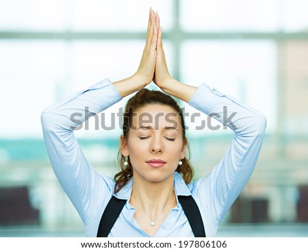 Closeup portrait beautiful hispanic businesswoman relaxing meditating eyes closed, indoors corporate building, office by doing some yoga isolated background windows. Positive emotion facial expression - stock photo