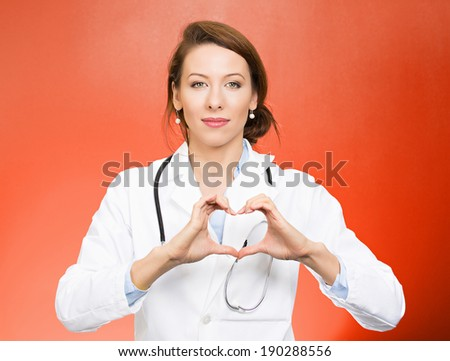 Closeup portrait, beautiful smiling cheerful health care professional, pharmacist, dentist, nurse making heart sign hands, isolated red background. Positive human emotion facial expression feeling - stock photo
