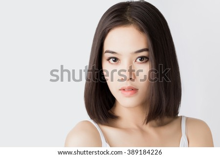 Closeup portrait beauty Asian woman face. Beautiful attractive Thai female studio shot. - stock photo