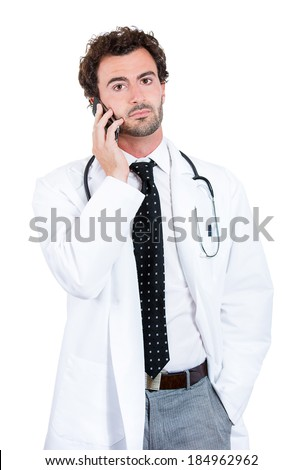 Closeup portrait, confident, handsome male health care professional, doctor, nurse, physician assistant, researcher, dentist, talking on cell phone about patient lab results, isolated white background - stock photo