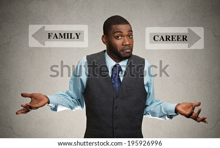 Closeup portrait confused, looking clueless business man arms out asking which way to go in life isolated black background with family, career arrows. Emotion facial expression feeling life perception - stock photo