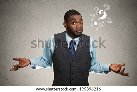 Closeup portrait dumb looking clueless business man, arms out asking why what's problem so what I don't know, isolated dark background. Negative human emotion facial expression feeling life perception - stock photo