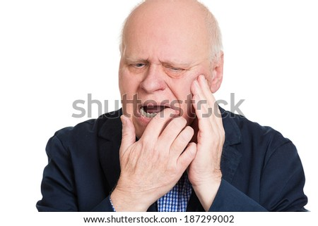 Closeup portrait elderly business man with tooth ache crown problem cavity crying from pain touching outside mouth with hand isolated white background. Negative human emotion facial expression feeling - stock photo