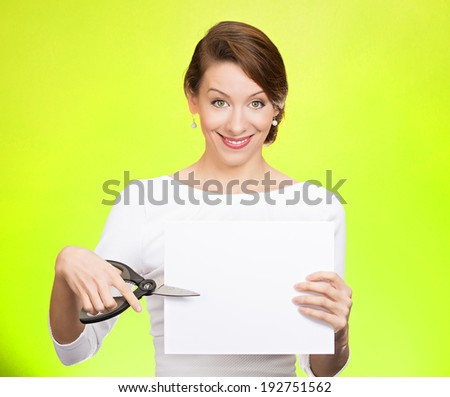 Closeup portrait, excited, happy, energetic enthusiastic young business woman, funny female, worker, dedicated employee cutting blank white paper, copy space with scissors isolated green background. - stock photo