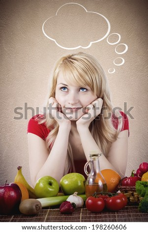 Closeup portrait fit happy smiling young woman, girl siting at table with fruits, vegetables, thinking, daydreaming, making healthy diet choices isolated grey background with bubble Positive emotions - stock photo