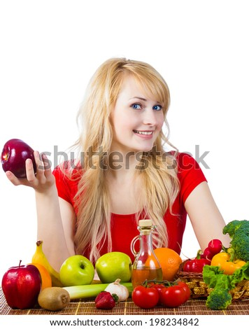 Closeup portrait fit, happy smiling young woman, nutritionist, girl holding red apple siting at table with fruits, vegetables, making healthy diet choices isolated white background. Positive emotions - stock photo