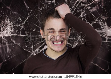 Closeup portrait, goofy, funny face, young man slapping hand on head to say duh, isolated brown background, shattered glass. Negative human emotion facial expression feelings, reaction, body language - stock photo