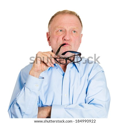 Closeup portrait, goofy senior mature business man playing, biting black glasses, bored out of his mind, isolated white background. Negative emotion facial expression feelings, reaction, attitude - stock photo