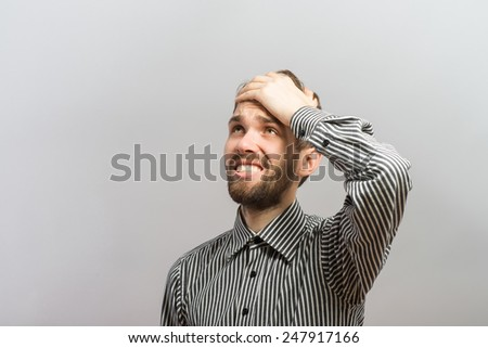 Closeup portrait, goofy, silly young man, slapping hand on head . Negative human emotion facial expression feelings, body language - stock photo