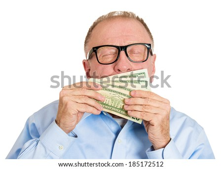 Closeup portrait, greedy senior executive, CEO, boss, corporate employee, mature man, holding, smelling dollar banknotes tightly, isolated white background. Negative human emotion facial expression - stock photo