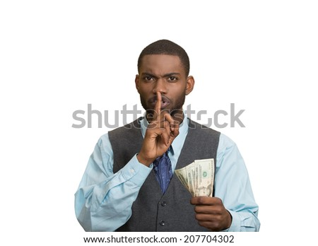 Closeup portrait handsome corrupt guy businessman holding dollar bill in hand showing shhh sign finger to lips isolated white background. Bribery concept politics, business diplomacy. Face expression - stock photo
