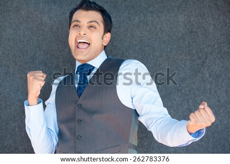 Closeup portrait, handsome excited, energetic, happy, smiling boss man winning, arms, fists pumped, celebrating success, isolated gray silver background. Positive emotion, facial expressions - stock photo