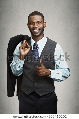 Closeup portrait happy, smiling, handsome business man in suit giving thumbs up isolated black grey background. Positive human emotions, face expression, attitude, life perception, thinking, approach  - stock photo