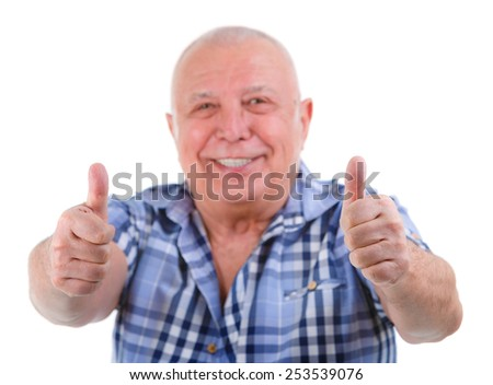 Closeup portrait, Happy smiling old man with white teeth, shows gesture two thumbs up on white. Focus on fingers, face blurred. Isolated - stock photo