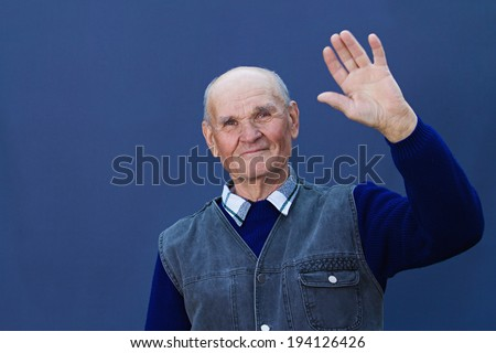 Closeup portrait, happy, smiling, senior, mature man making five times sign gesture with hand fingers, isolated black, blue background. Positive human emotion facial expression feeling attitude symbol - stock photo