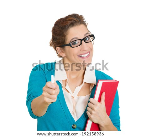 Closeup portrait, happy, smiling young female teacher, instructor, with glasses, holding book, pointing at you, copy space. Positive emotions, facial expressions, attitude, reaction, education concept - stock photo