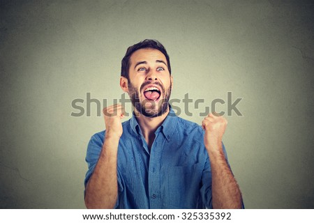 Closeup portrait happy successful student, business man winning, fists pumped celebrating success isolated grey wall background. Positive human emotion facial expression. Life perception, achievement - stock photo