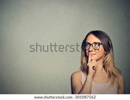 Closeup portrait happy young woman thinking dreaming has ideas looking up isolated on gray wall background copy space. Positive human emotion feeling life perception. Decision making process concept. - stock photo