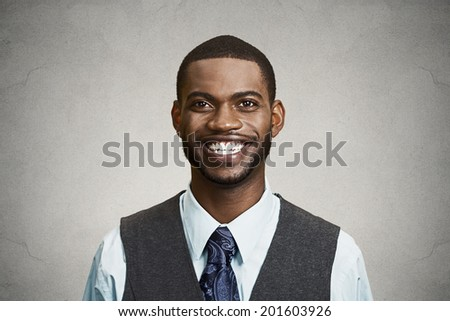 Closeup portrait, headshot, handsome happy, young, smiling business man, confident student, real estate agent, isolated black grey background. Positive face expressions, emotions, feelings, attitude - stock photo
