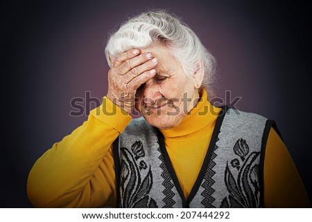Closeup portrait, headshot sad alone dark gloomy frustrated, stressed senior mature woman having bad headache, nightmare day isolated black background. Negative human emotion facial expression feeling - stock photo