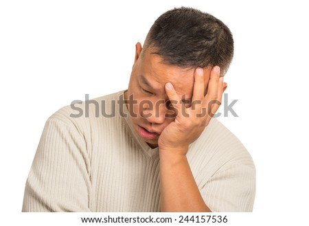 Closeup portrait headshot sad bothered stressed middle aged man holding head with hand really depressed about something isolated on white background. Negative human emotion facial expression feeling - stock photo