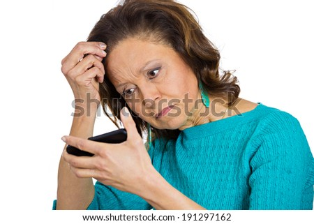 Closeup portrait, headshot shocked funny looking woman, feeling head, surprised, losing hair, receding hairline, upset isolated white background. Negative human facial expression, emotion, reaction - stock photo