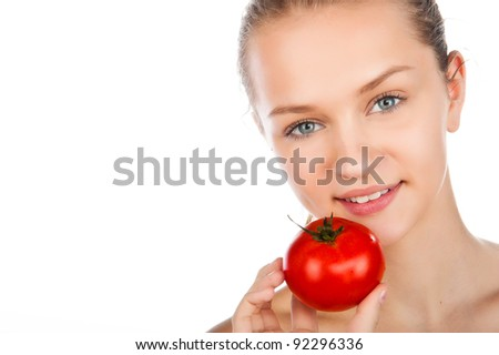 closeup portrait if beauty young woman in yellow shirt with tomato, woman holding ripe tomato,  juiced red tomato, white background