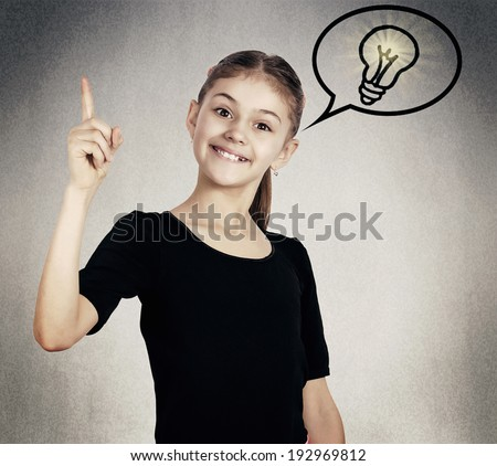 Closeup portrait intelligent, excited, little girl who just came up with idea aha, isolated great black background with lighting bulb. Positive human emotions, facial expressions, attitude, perception - stock photo