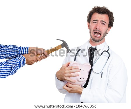 Closeup portrait, male healthcare professional, doctor, nurse with stethoscope protecting piggy bank, someone trying crack open to take out and steal his money, isolated white background.  - stock photo