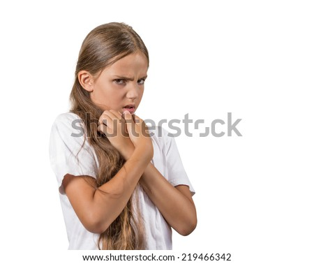 Closeup portrait nervous anxious stressed teenager girl looking anxiously afraid of someone, something isolated white background. Negative human emotion facial expression body language, perception - stock photo