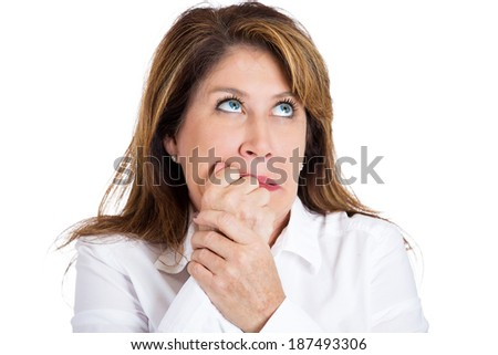 Closeup portrait, nervous middle age woman biting fingernails craving for something, anxious isolated white background. Negative human emotions, facial expressions, feelings, reaction life perception - stock photo