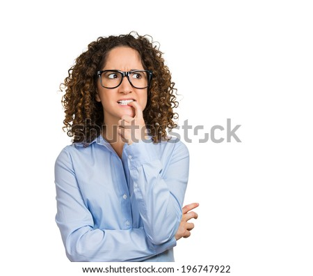 Closeup portrait nervous woman with glasses biting her fingernails craving for something, anxious, isolated white background with copy space. Negative human emotions, facial expressions, body language - stock photo