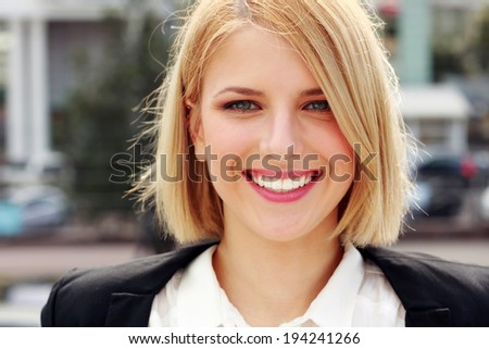 Closeup portrait of a attractive smiling woman - stock photo