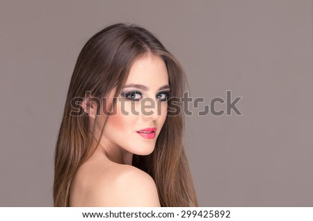 closeup portrait of a beautiful blond young girl posing wearing makeup - stock photo
