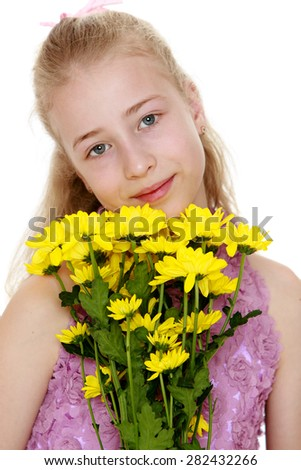 Closeup portrait of a beautiful girl who hugs bouquet of yellow flowers- isolated on white background - stock photo