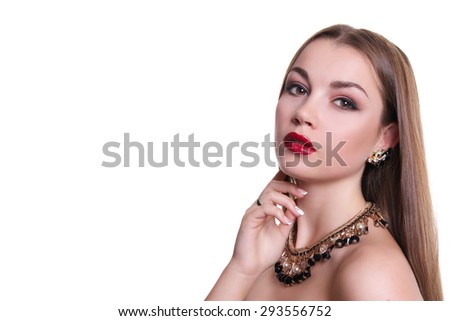 Closeup portrait of a beautiful girl with a black and gold necklace around her neck. Isolated over white background. Copy space.  - stock photo