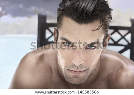 Closeup portrait of a beautiful male model with blue eyes and great hair - stock photo