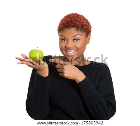 Closeup portrait of a beautiful, smiling personal trainer nutritionist professional holding an apple, isolated on a white background. Healthy food choices. Positive human facial expression, emotions - stock photo