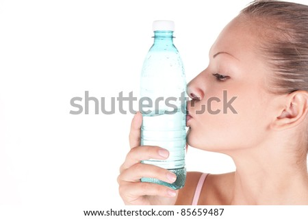 Closeup portrait of a beautiful woman kissing bottle of water