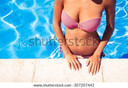 Closeup portrait of a beautiful woman standing in swimming pool