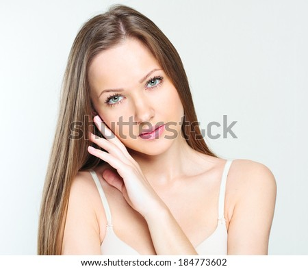 closeup portrait of a beautiful woman with beauty face and clean skin